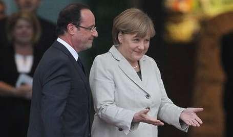 Hollande ilk ziyaretini Merkel'e yaptı