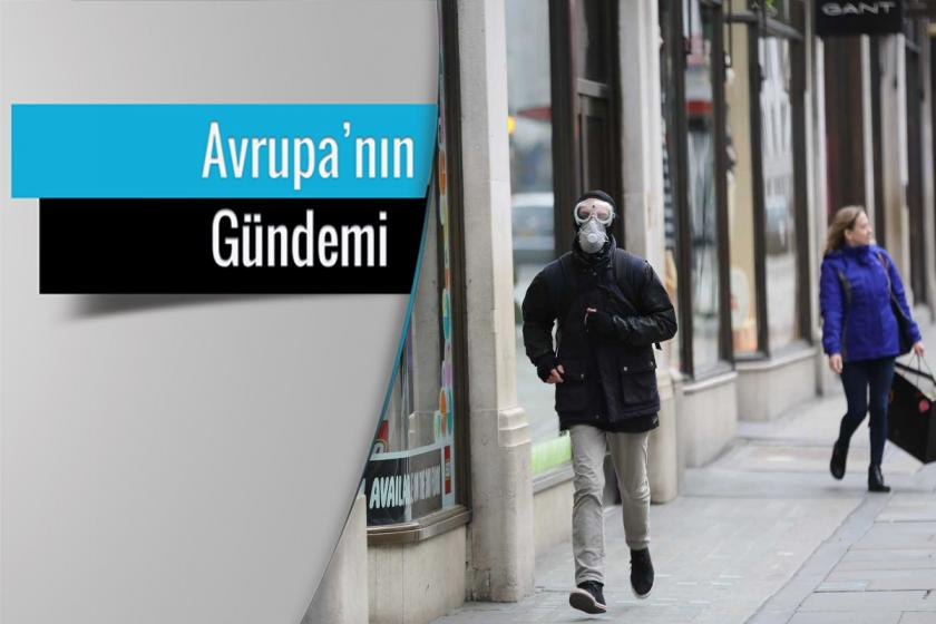 İngiltere'de koronavirüs (Kovid-19) salgını yüzünden dışarıda maske ve koruyucu gözlükle koşan bir erkek.