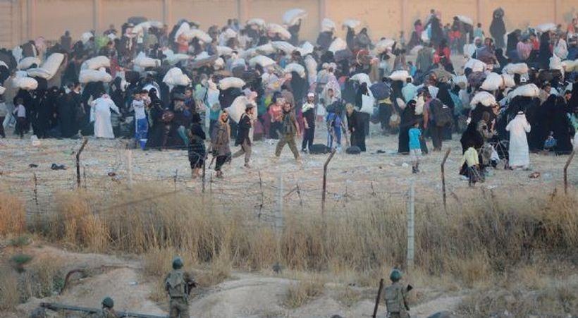 IŞİD militanları Til Ebyad'lıları zorla kente döndürdü