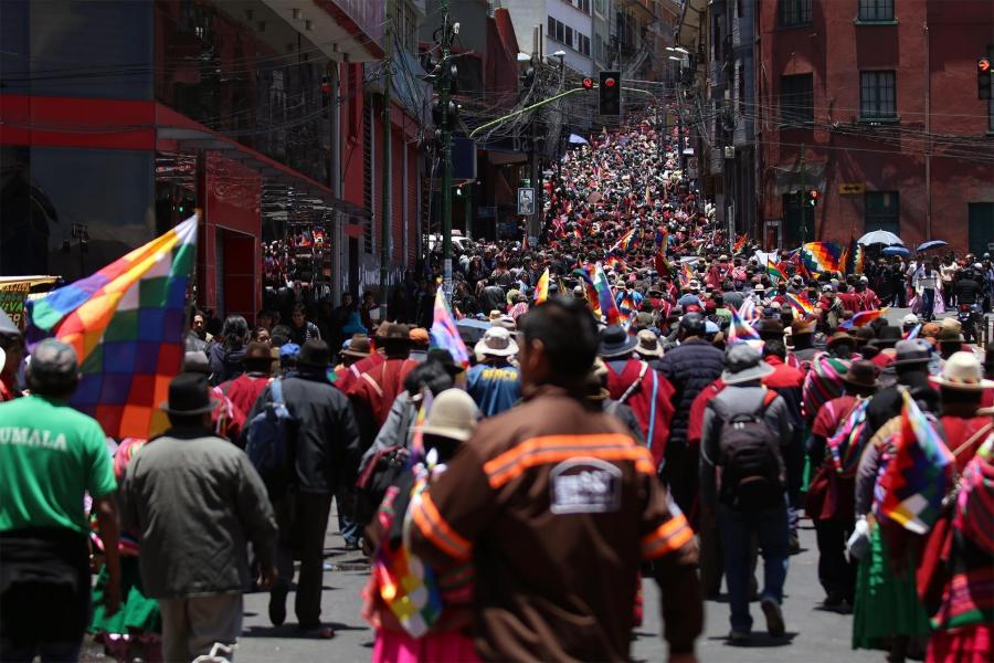Bolivians gathered  in La Paz, with Wiphala flags in their hands to protest the coup.