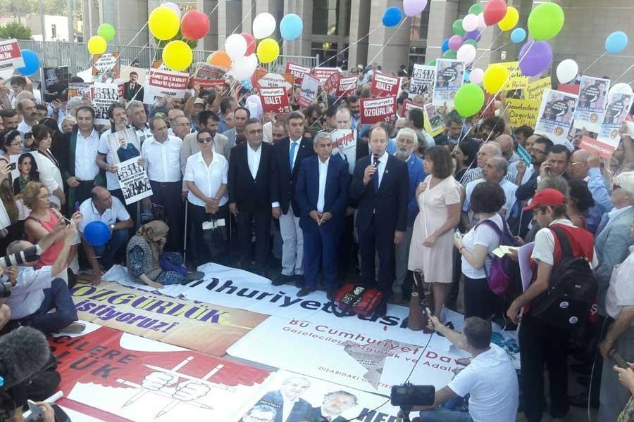 The trial of 17 employees of Cumhuriyet newspaper began