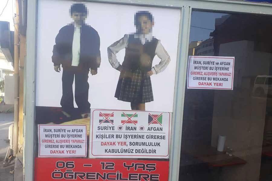 Irkçı afiş asan esnafa 1000 lira para cezası verildi, 'uyarı' cezasına çevrildi