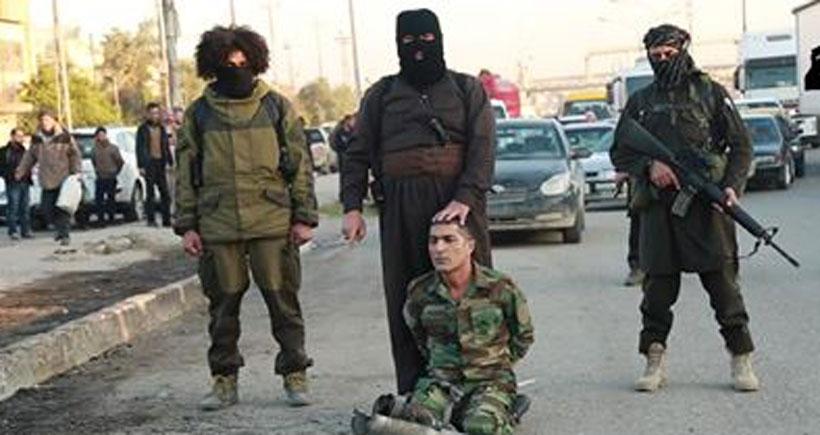 'Hucam Surçi'nin kafasını kesen IŞİD'li öldürüldü'