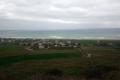 Yeniköy\'de tarım arazileri ve sahil.