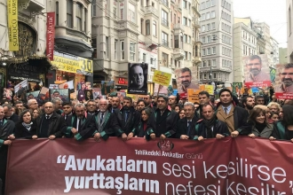 Lawyers march in their robes on Day of the Endangered Lawyer