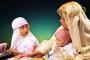 MEB'in ders kitabında kundaktaki bebeğe bile türban takıldı